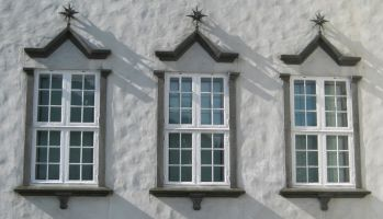 a photo of three individual windows that make up a whole symbolising a theory of mind which integrates repression and spitting in a dissociation framework